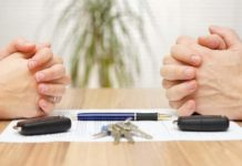 Car dealer discusses car finance in a car showroom