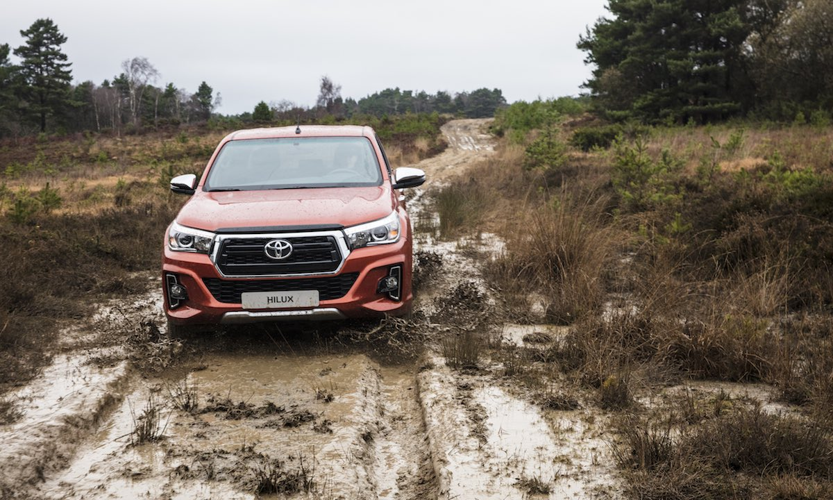 Toyota Hilux Invincible X on a muddy trail