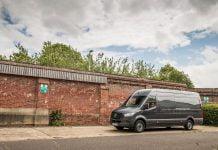 Mercedes-Benz Sprinter alongside a wall | The Van Expert